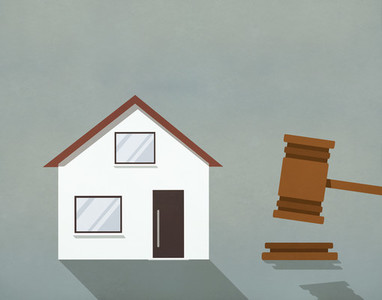 House up for auction next to gavel 01