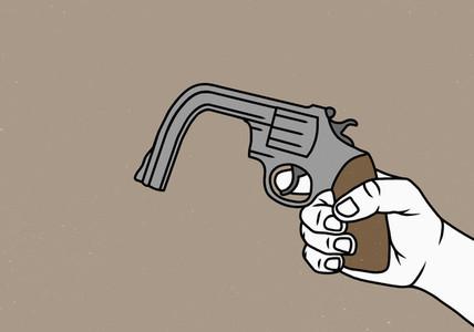 Hand holding bent gun 01