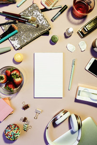View form above notepad surrounded by personal belongings on desk 01