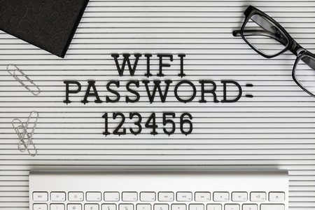 View form above Wifi Password 123456 on desk above computer keyboard 01