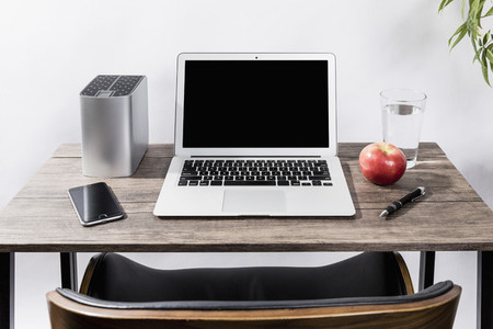 Laptop smart phone apple water and pen on desk 01