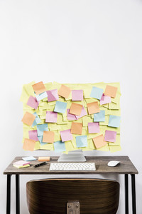 Adhesive notes covering computer in office 01