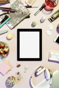 View form above digital tablet surrounded by personal belongings 01
