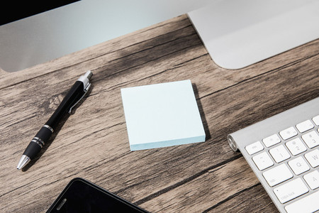 Adhesive note pad and pen on desk 01