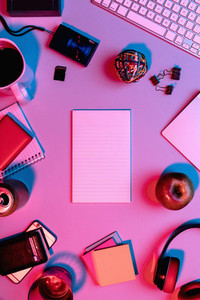 View form above blank notepad on desk surrounded by office supplies 01