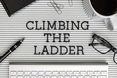 View from above Climbing the Ladder text on desk 01