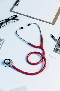 Stethoscope and eyeglasses on desk 01