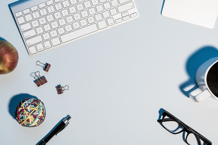 View form above computer keyboard and office supplies 01