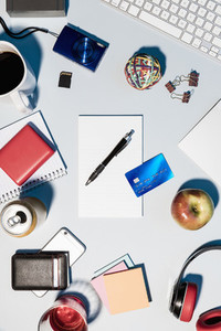 View from above credit card and office supplies on desk 01