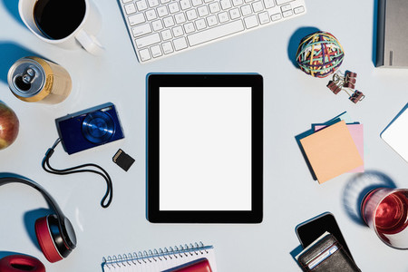 View form above digital tablet surrounded by office supplies on desk 01