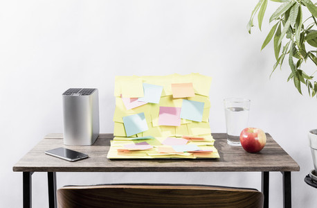 Adhesive notes covering laptop on desk in office 01