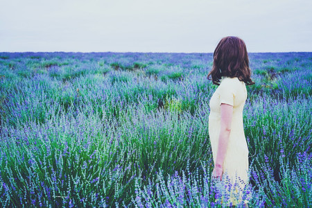 Back view of a young woman in a field of lavender