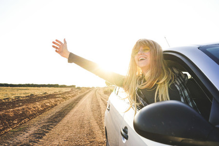 Young woman in a road trip enjoying the journey