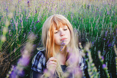 Young woman enjoying the day in a field of lavender