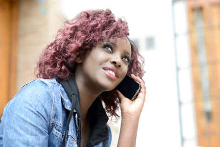 Beautiful black woman in urban background on the phone