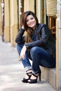 Beautiful japanese woman smiling in urban background wearing lea