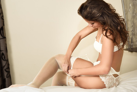 Sexy young woman wearing white bride underwear
