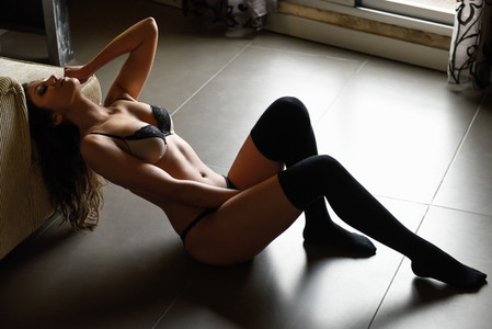 Sexy young woman dressed in lingerie