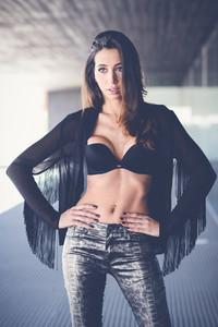 Woman wearing transparent shirt and black bra