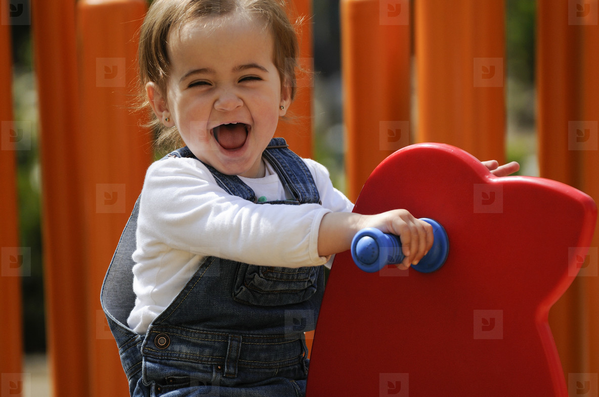 Little girl playing in a urban playground