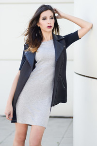 Woman wearing wearing dress and vest