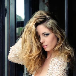 Sexy blonde woman model of fashion in window