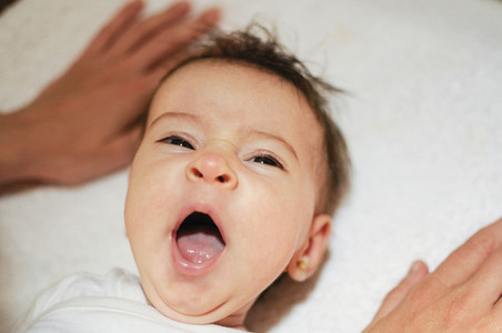 Baby girl two months old yawning