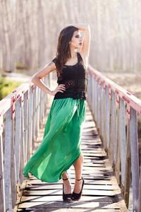 Woman wearing long dress in a rural bridge