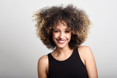 Young black woman with afro hairstyle smiling