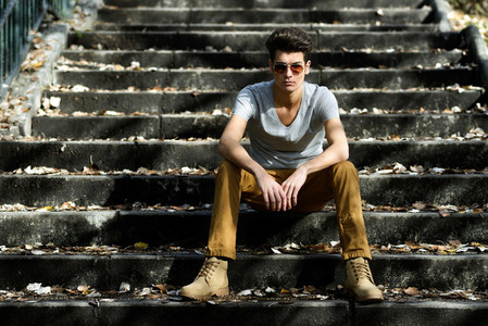 Attractive young handsome man model of fashion in stairs