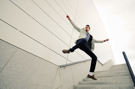 Man model of fashion jumping and wearing jacket and shirt
