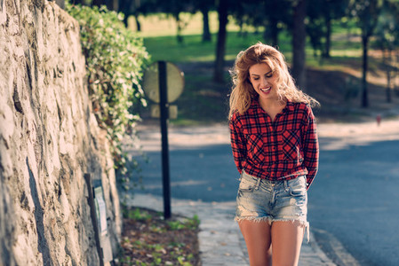 Beautiful woman with long blond curly hair
