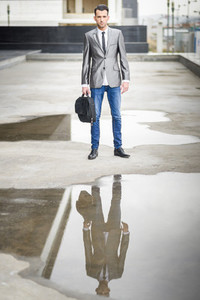 Young businessman near a office building