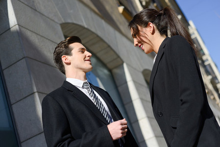 Business people talking outside of company building  Couple work