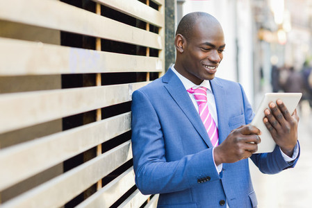Black businessman using tablet