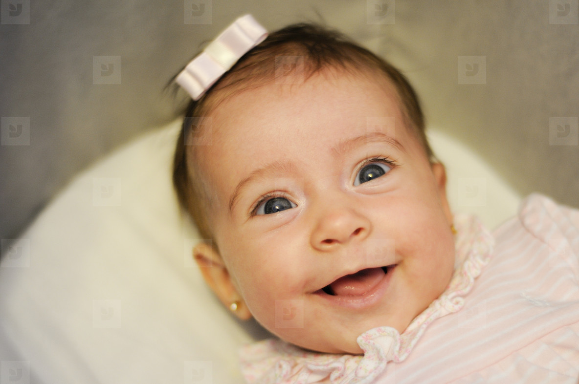 Baby girl two months old smiling
