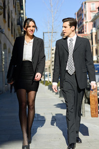 Attractive business people walking on the street Couple working