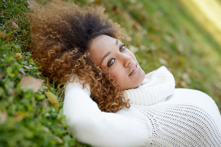 Young African American girl with afro hairstyle and green eyes