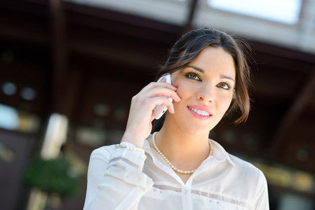 Beautiful smiling businesswoman on the phone in a office buildin