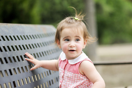 Little girl playing in a urban park