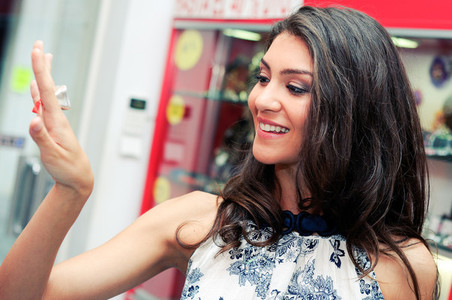 Attractive young woman trying on a ring at a jewelry