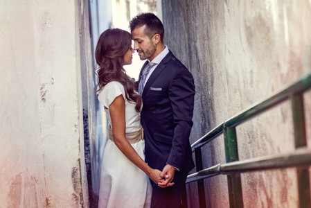 Just married couple in urban background