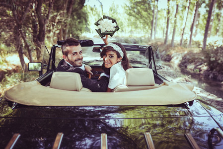 Just married couple in an old car