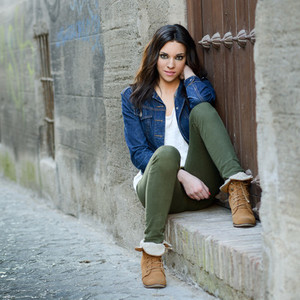 Young beautiful woman in a urban background
