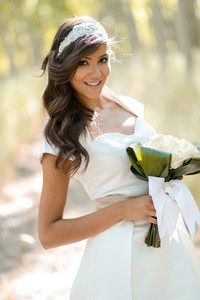 Beautiful bride outdoors in a forest