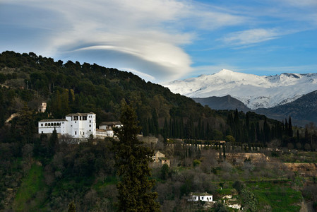 Alhambra and snowing Sierra Nevada mountains under a lenticular