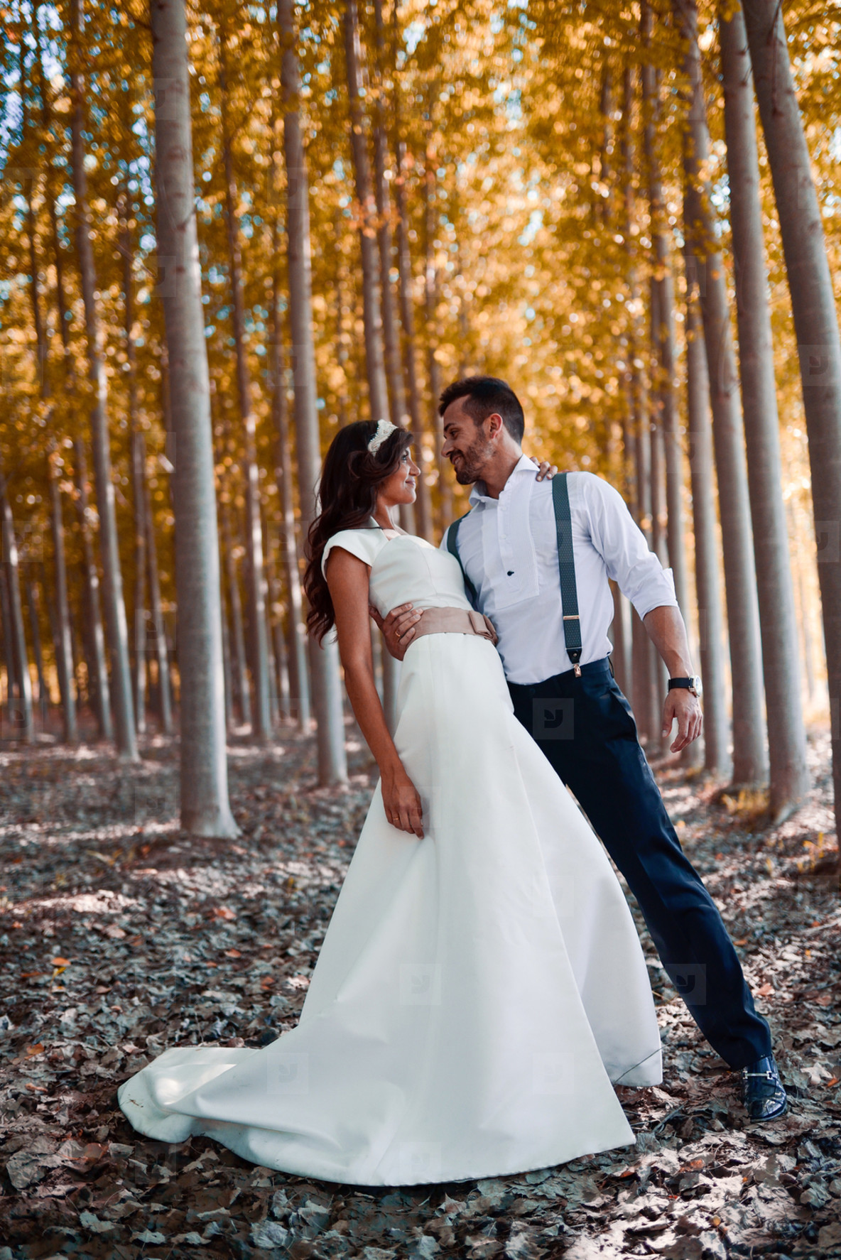 Just married couple in poplar background