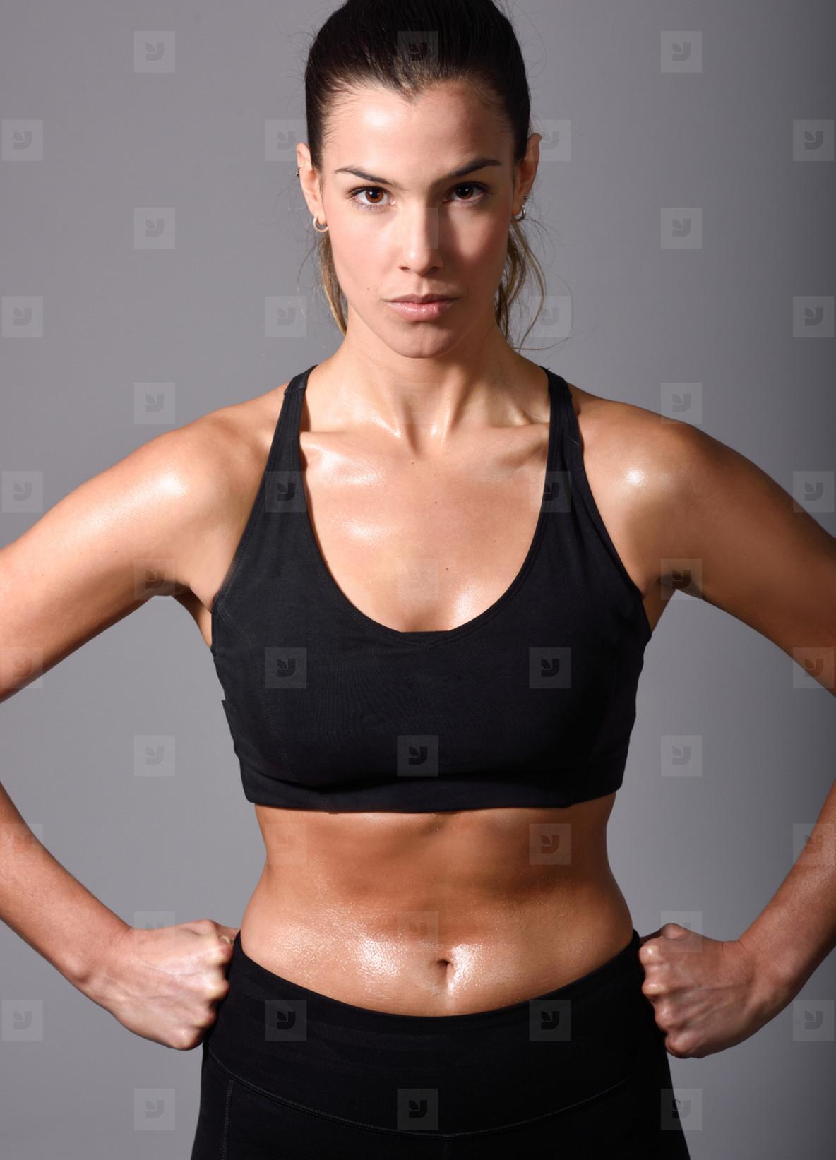 Woman  personal trainer  wearing black sportswear