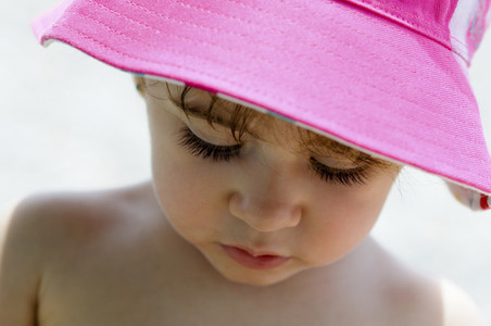 Close up potrait of adorable little girl wearing sun hat