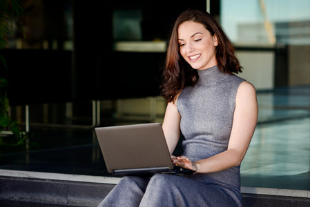Businesswoman using her laptop computer in a modern office build